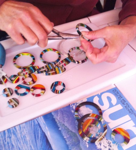Donna wiring up the upcycled surfboard resin earrings