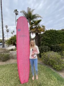 pink surf board and Sierra Partridge